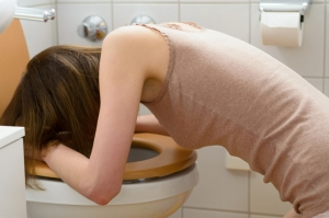 Wombourne Hypnotherapy for emetophobia - woman being sick in toilet