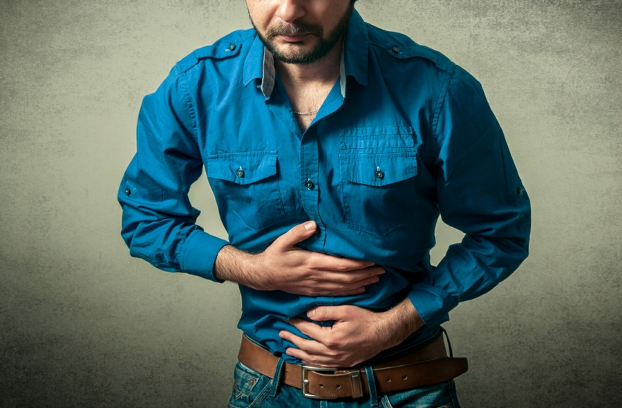 Hypnotherapy for Irritable Bowel Syndrome in Wolverhampton and Wombourne - Man with Stomach Cramps
