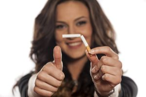 Wombourne Hypnotherapy to stop smoking - woman breaking cigarette