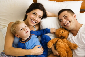 emetophobia-therapy-wolverhampton-family-with-young-child-in-bed