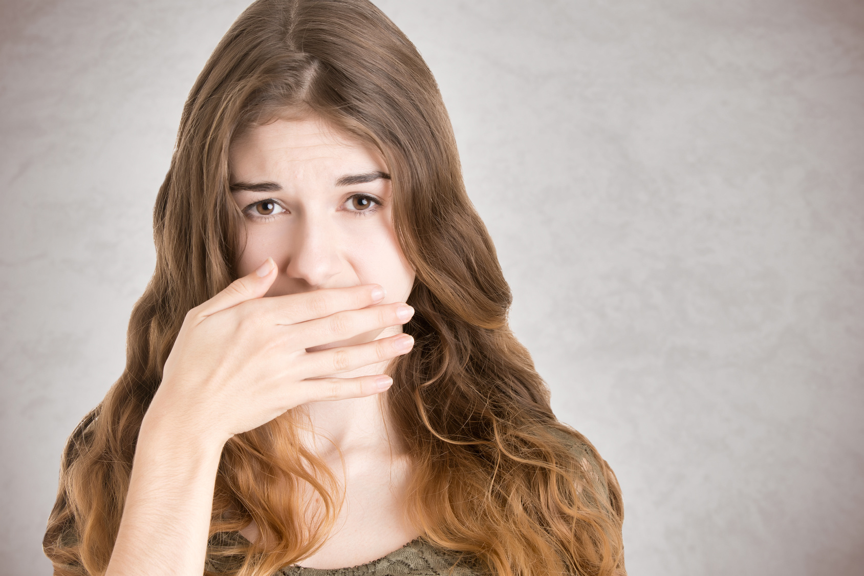 Hypnotherapy for Blushing in Wolverhampton and Wombourne - woman covering mouth