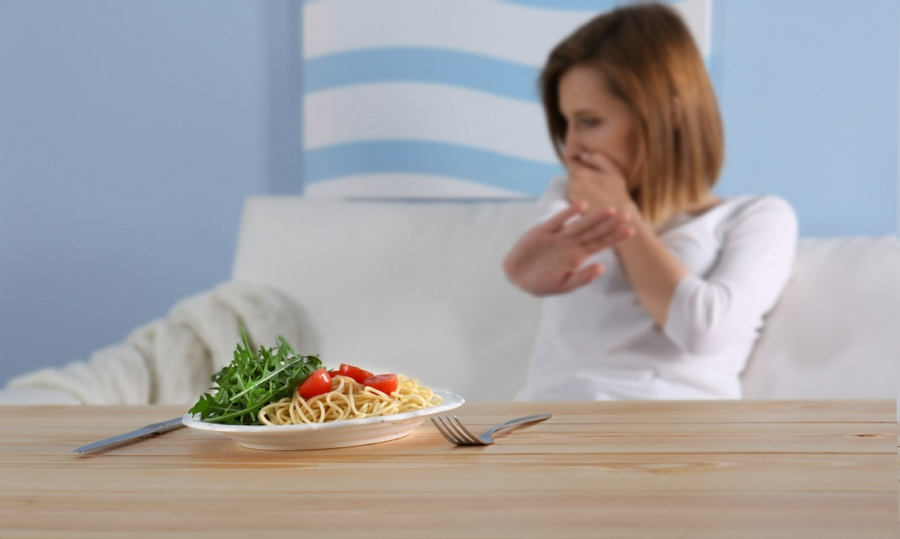 Eating Problems Wolverhampton and Wombourne - woman avoiding healthy food